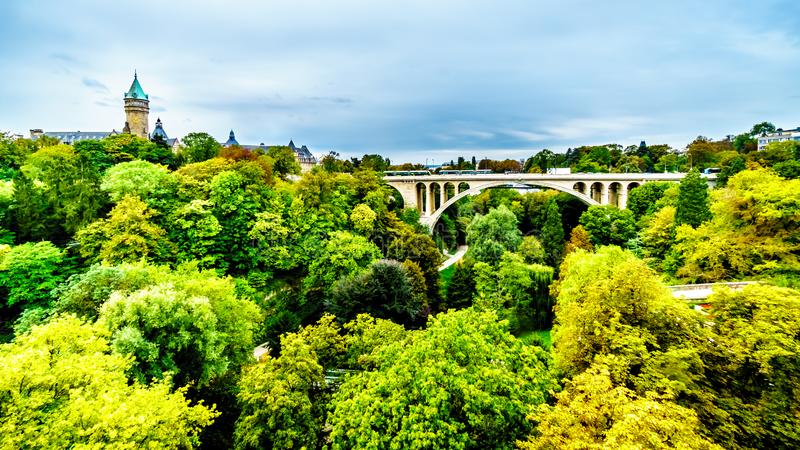The Pont Adolphe and Vallé de la Pétrusse in the city of Luxumbourg stock photography