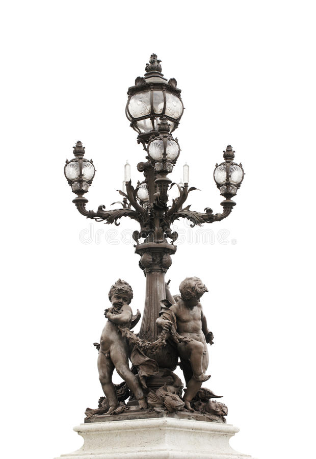 Pont Alexandre III. Ornate lamp post of Pont Alexandre III bridge in Paris, France royalty free stock images