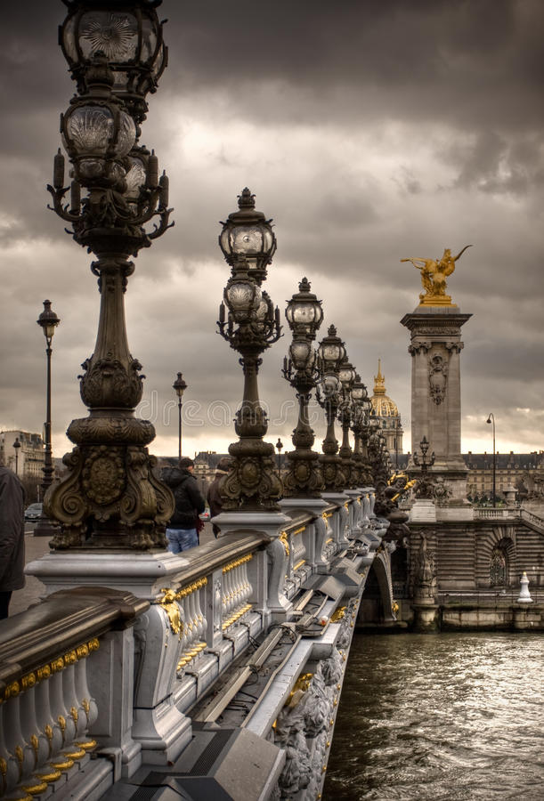 Pont Alexandre III - Bridge in Paris, France. Gloomy winters day royalty free stock image