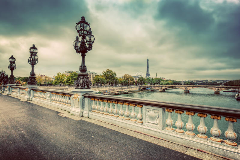 Pont Alexandre III bridge in Paris, France. Seine river and Eiffel Tower. stock photo