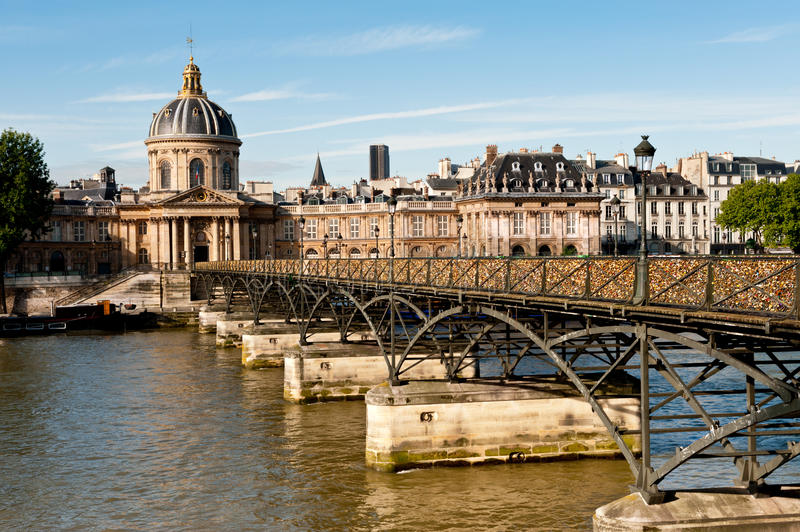 Pont des Arts in Paris. Paris, Pont des Arts in the bright Summer morning stock images