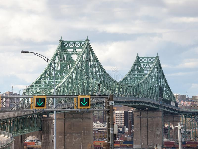 Pont Jacques Cartier bridge taken in the direction of Montreal, in Quebec, Canada on the Saint Lawrence river,. LONGUEUIL, CANADA - NOVEMBER 8, 2018: It is a royalty free stock photo