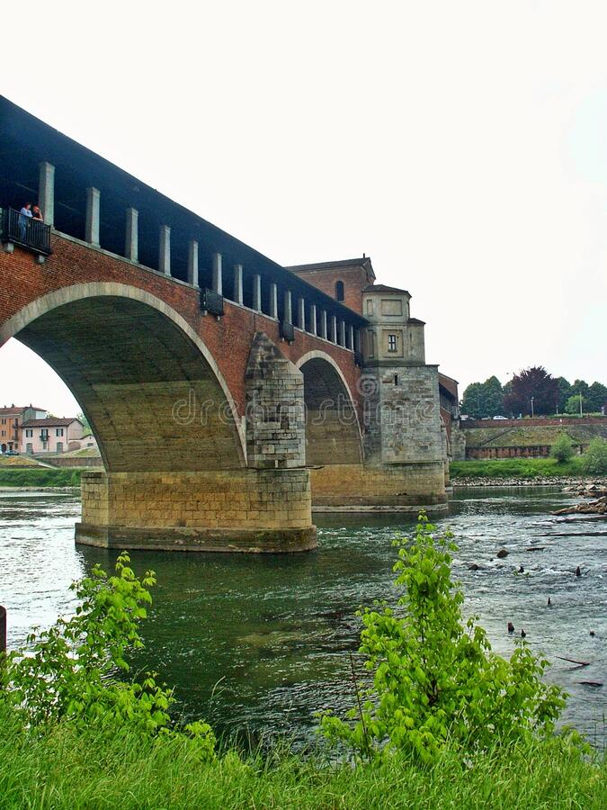 The Ponte Coperto Covered Bridge also known as Ponte Vecchio Old Bridge. Is a brick and stone arch bridge over the Ticino River in Pavia royalty free stock image