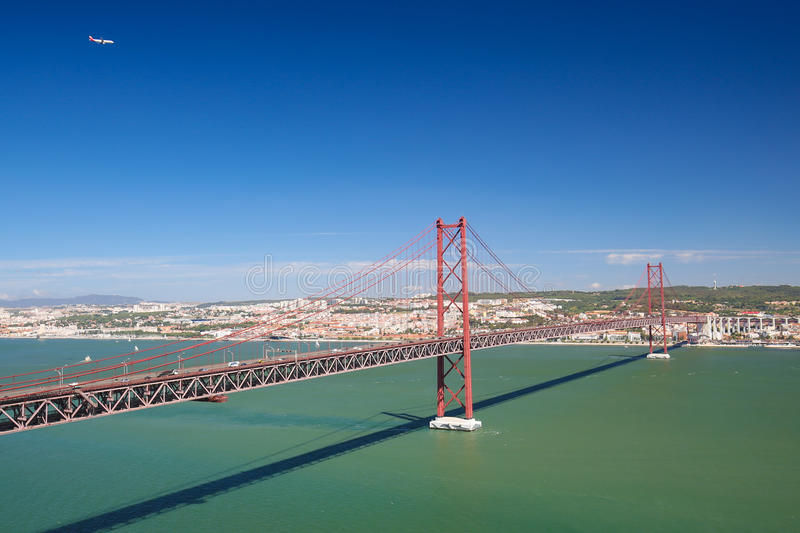 Ponte 25 de Abril in Lisbon, Portugal. Ponte 25 de Abril across the Tagus river and view on the center of Lisbon, Portugal royalty free stock photos