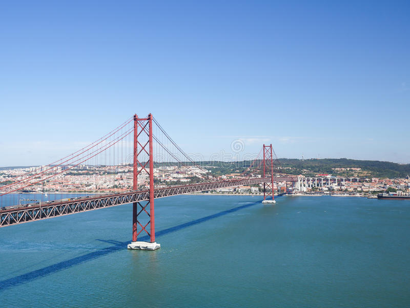 Ponte 25 de Abril in Lisbon, Portugal. Ponte 25 de Abril across the Tagus river and view on the center of Lisbon, Portugal stock image