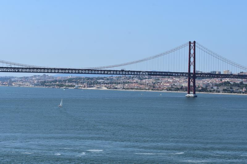 Ponte 25 de Abril Lisbon. A view of the Ponte 25 de Abril bridge in Lisbon and Lisbon coast in the background royalty free stock photography
