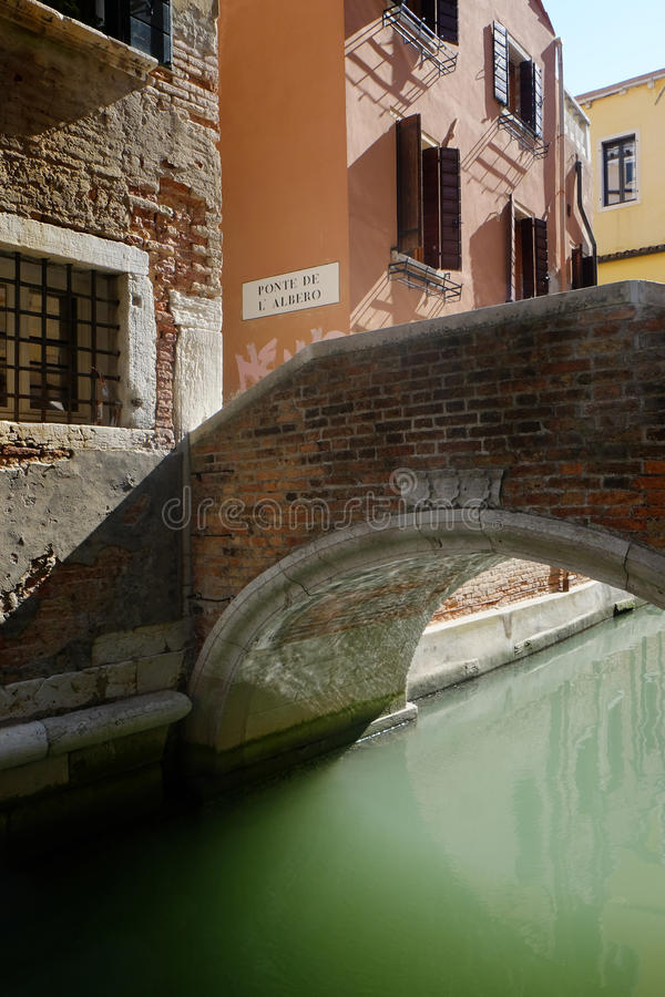 Ponte de l'arbero, bridge in the San Marco area of Venice. Bridge over side canal in Venice with tranquil water stock photos