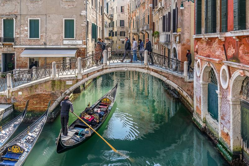 Ponte de la Cortesia in Venice Italy. Venice,Italy on 25th Mar 2018: Ponte de La Cortesia is just one of the many foot bridges across the network of canals in royalty free stock images