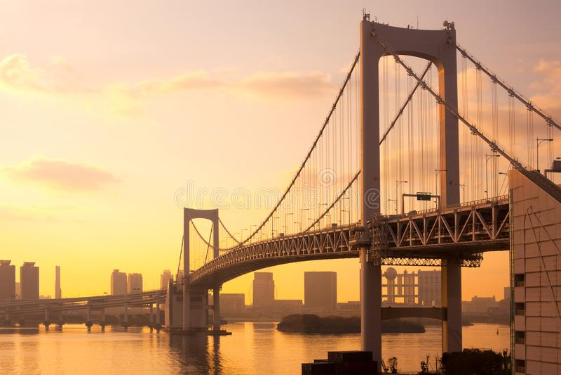 Ponte dell'arcobaleno al tramonto fotografia stock