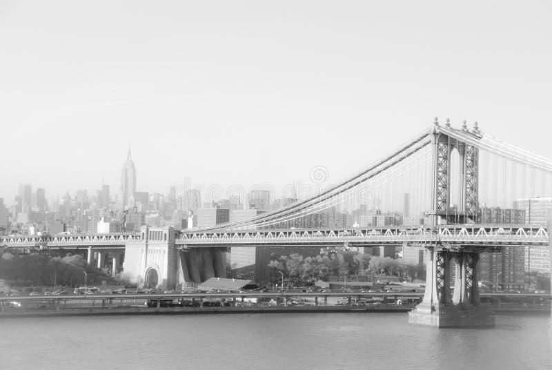 Ponte e Empire State Building de Brooklyn em New York imagem de stock royalty free
