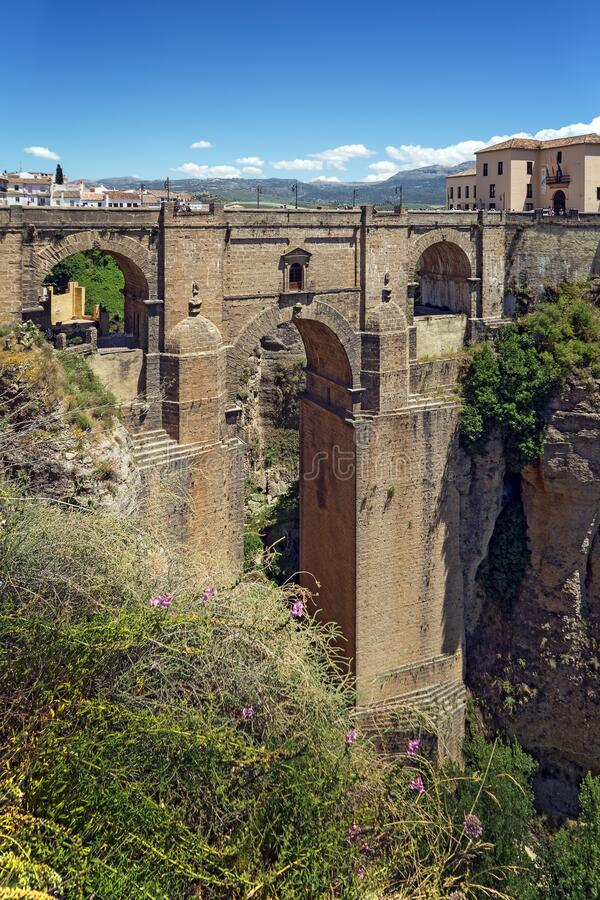 Ponte Nuevo the New Bridge in Ronda, Spain. This bridge spans the 120-metre-deep 390 ft chasm that carries the Guadalevín River and divides the city of stock image