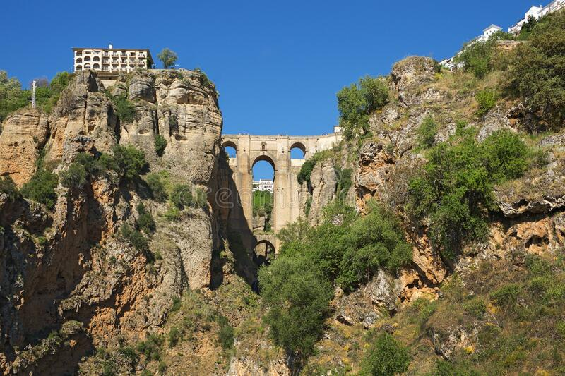 Ponte Nuevo the New Bridge in Ronda, Spain. This bridge spans the 120-metre-deep 390 ft chasm that carries the Guadalevín River and divides the city of royalty free stock image