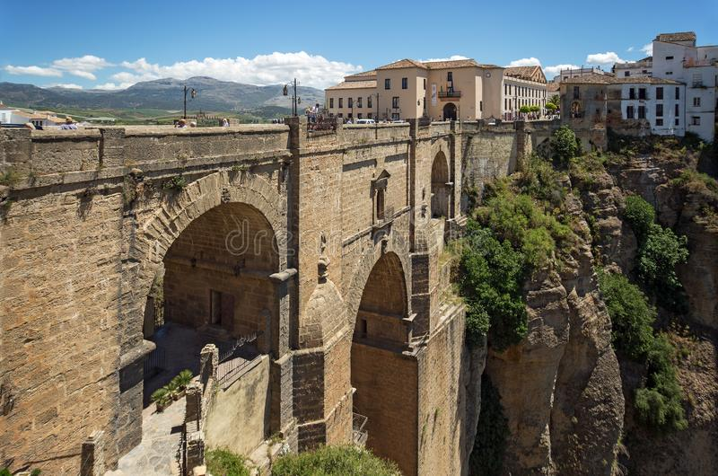 Ponte Nuevo the New Bridge in Ronda, Spain. This bridge spans the 120-metre-deep 390 ft chasm that carries the Guadalevín. River and divides the city of stock images