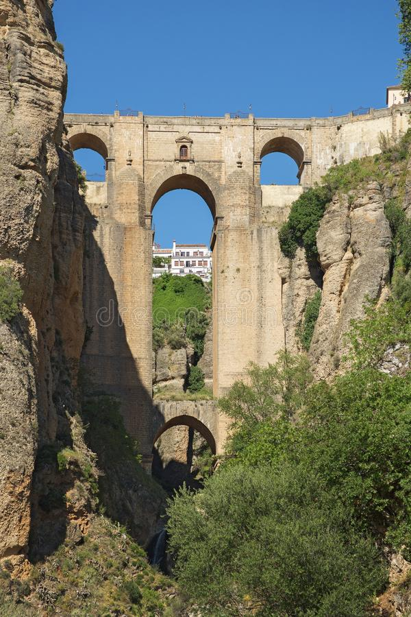 Ponte Nuevo the New Bridge in Ronda, Spain. This bridge spans the 120-metre-deep 390 ft chasm that carries the Guadalevín River and divides the city of royalty free stock photos
