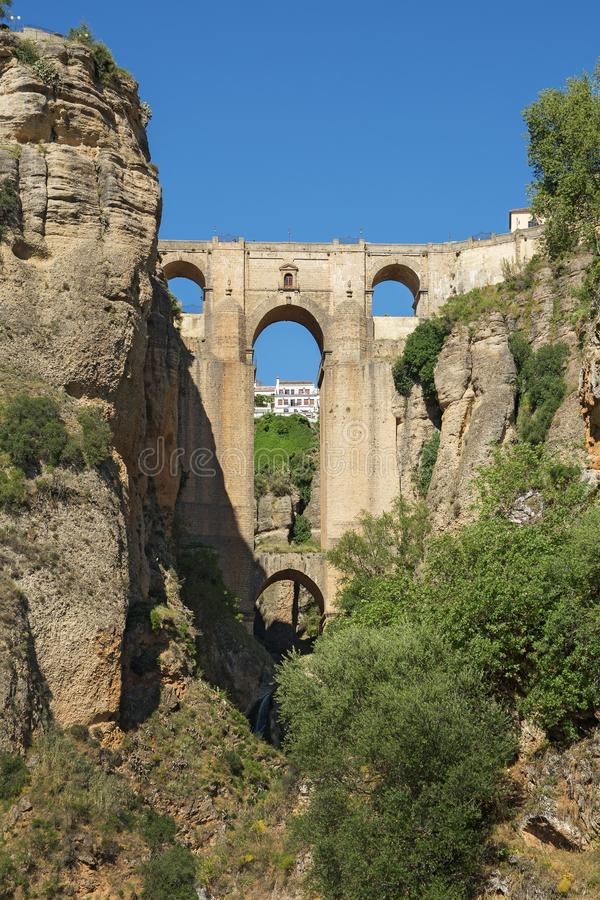 Ponte Nuevo the New Bridge in Ronda, Spain. This bridge spans the 120-metre-deep 390 ft chasm that carries the Guadalevín River and divides the city of stock photo