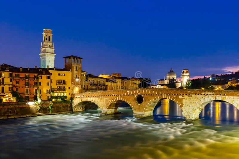 Ponte Pietra and Adige at night, Verona, Italy stock photo