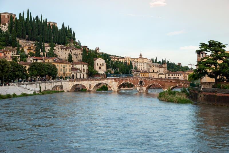 The Ponte Pietra or `Stone Bridge` - arch bridge crossing the Adige River in Verona, Italy. VERONA, ITALY - JUNE 18, 2010: The Ponte Pietra or `Stone Bridge` royalty free stock images