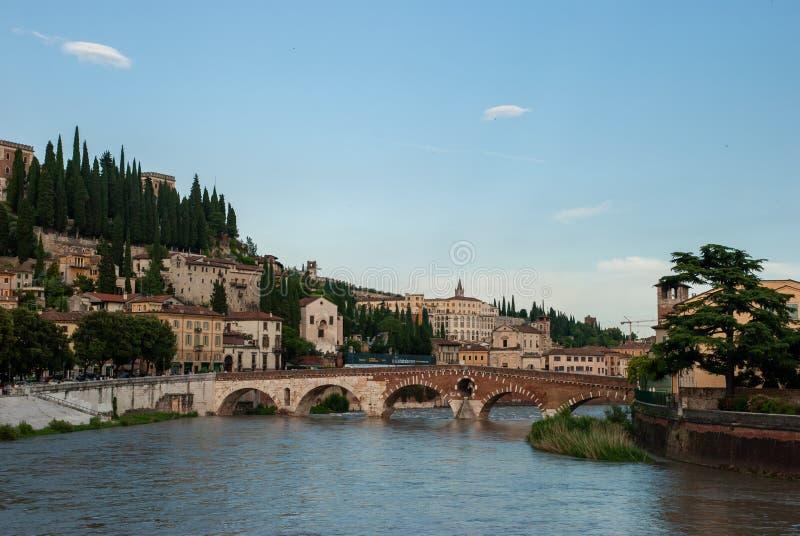 The Ponte Pietra or `Stone Bridge` - arch bridge crossing the Adige River in Verona, Italy. VERONA, ITALY - JUNE 18, 2010: The Ponte Pietra or `Stone Bridge` stock photography