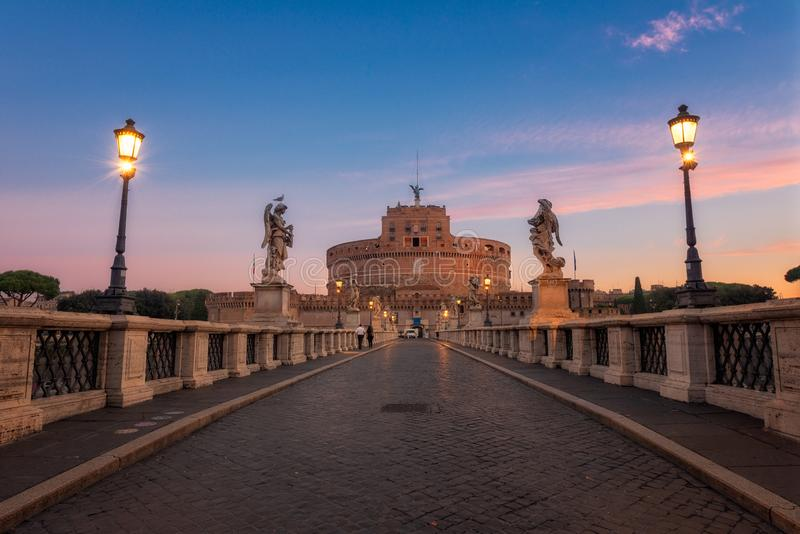 Ponte Sant Angelo at dawn with Castel Sant Angelo in background. Castel Santangelo fortress and bridge view in Rome, Italy. Sain royalty free stock images