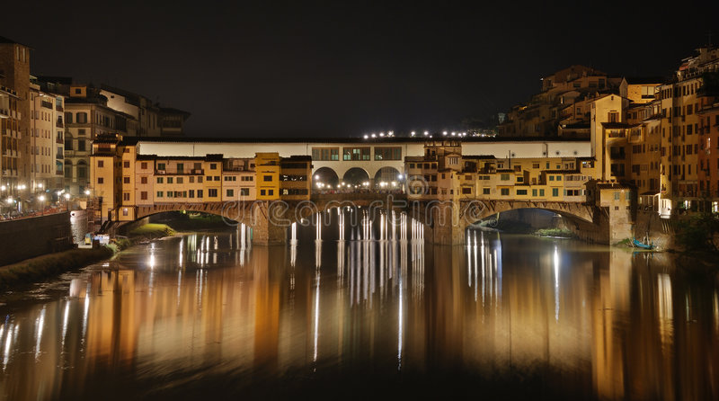 Ponte vecchio. At night, Florence, Italy stock images
