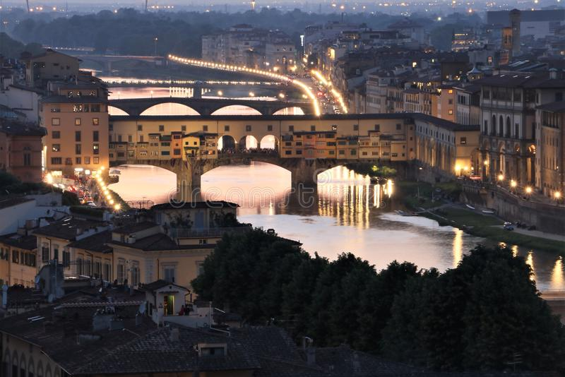 Ponte Vecchio bridge in Florence at dusk. The famous landmark Ponte Vecchio bridge in Florence Tuscany, Italy at dusk royalty free stock photography