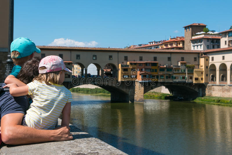 Ponte Vecchio, Florence. Watching Ponte Vecchio. It is a Medieval stone closed-spandrel segmental arch bridge over the Arno River, in Florence, Italy, noted for stock photo