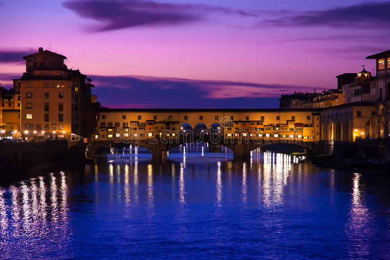 The Ponte Vecchio by night. In the city of Florence stock images