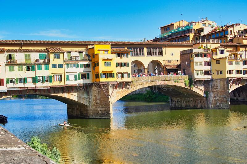 Ponte Vecchio Bridge Over the Arno River, Florence, Italy. The medieval shop lined Ponte Vecchio Bridge crossing the Arno River, Florence, Italy, with a single royalty free stock photography
