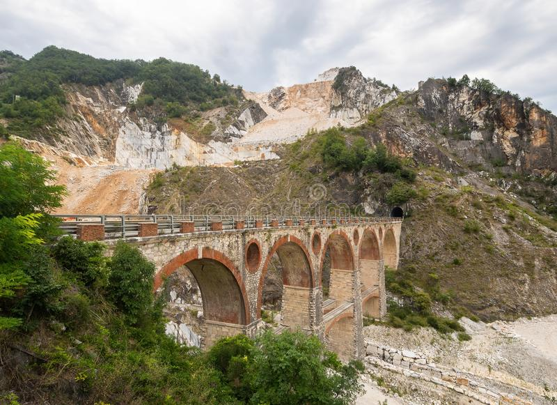 Ponti di Vara bridges in Carrara marble quarries, Tuscany, Italy. In the Apuan Alps. Quarrying marble stone is an. Important industry royalty free stock photo