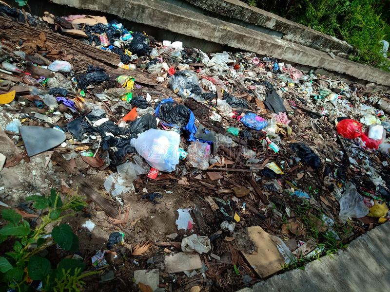 Pontianak, INDONESIA - April 14, 2019: Illegally-dumped garbage and plastic bags contaminate agricultural land on April 14, 2019 i. N Pontianak,west kalimantan royalty free stock photos