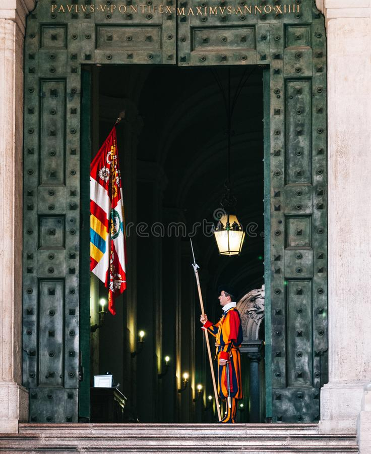 Pontifical swiss guard. Swiss Pontifical guard standing guard in a door rome security traditional uniform tourism military holy army europe peter papal vatican royalty free stock photos
