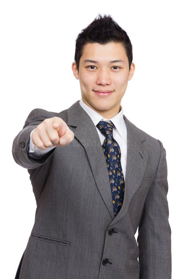 Ponto asiático do homem de negócios a você fotos de stock