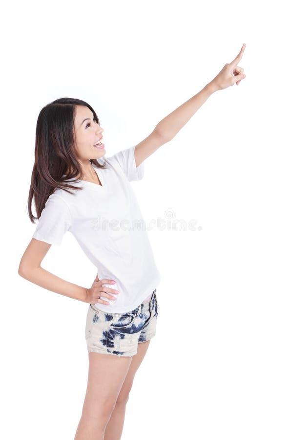 Ponto da mulher nova para copiar à mão o dedo do espaço fotos de stock