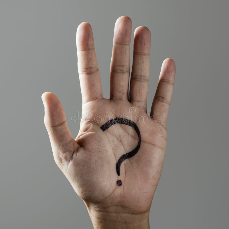 Ponto de interrogação na palma de um homem foto de stock