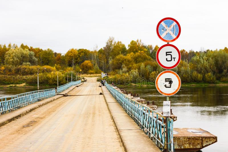 Ponton bridge with traffic signs over the Klyazma River in Gorokhovets. Ponton bridge with traffic signs over the Klyazma River. Gorokhovets, Vladimir oblast royalty free stock image