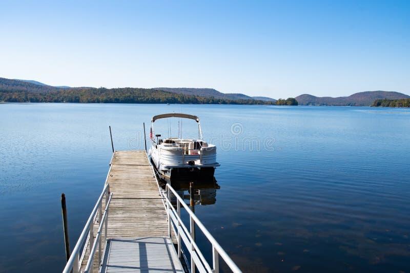 Pontoon boat at dock royalty free stock image