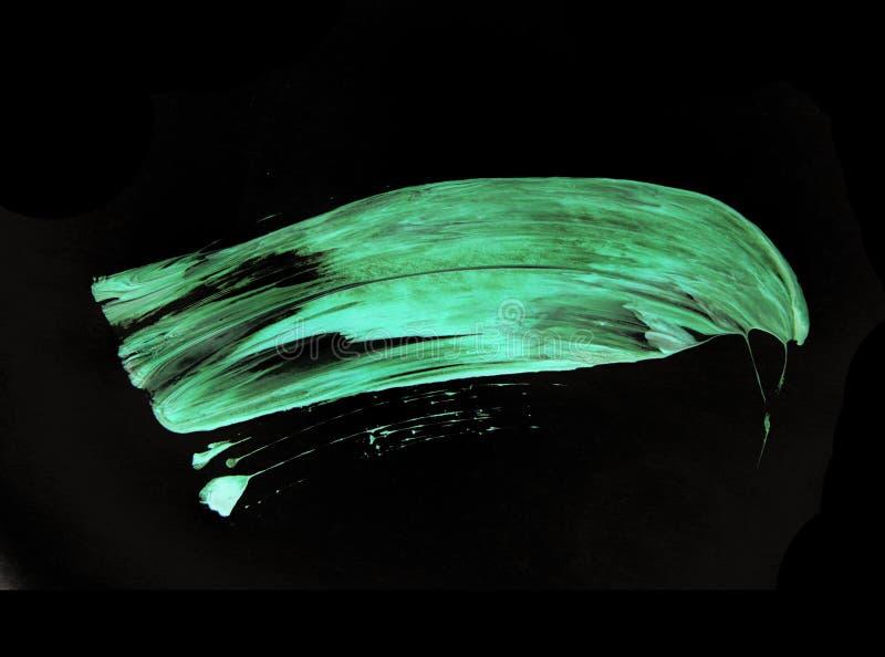 Pontos azuis verdes da escova de pintura no fundo preto foto de stock