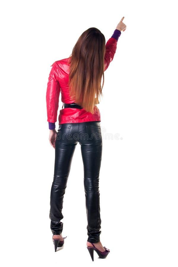 Pontos da mulher nova na parede. A vista traseira. imagem de stock