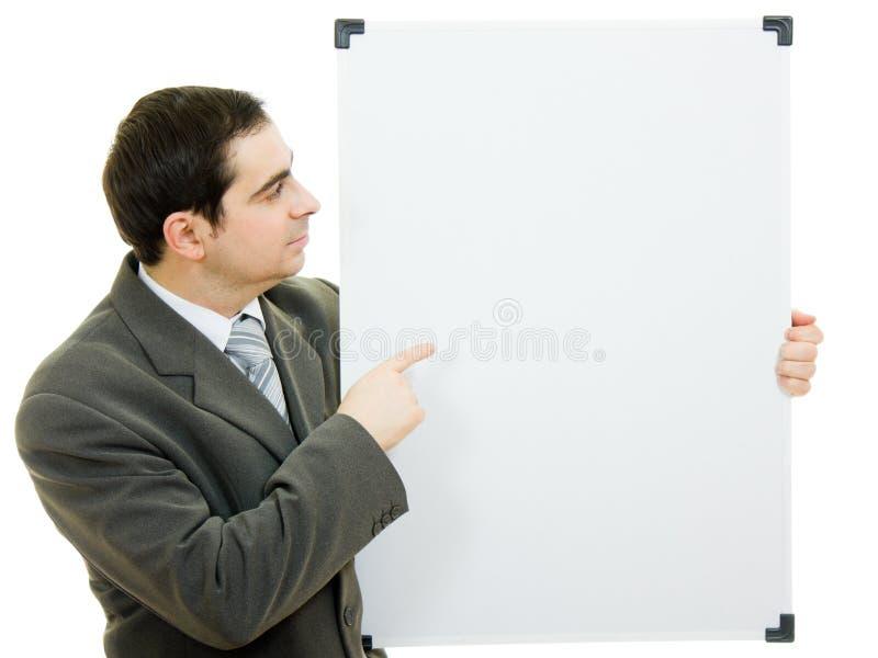 Pontos do homem de negócios à placa branca fotos de stock