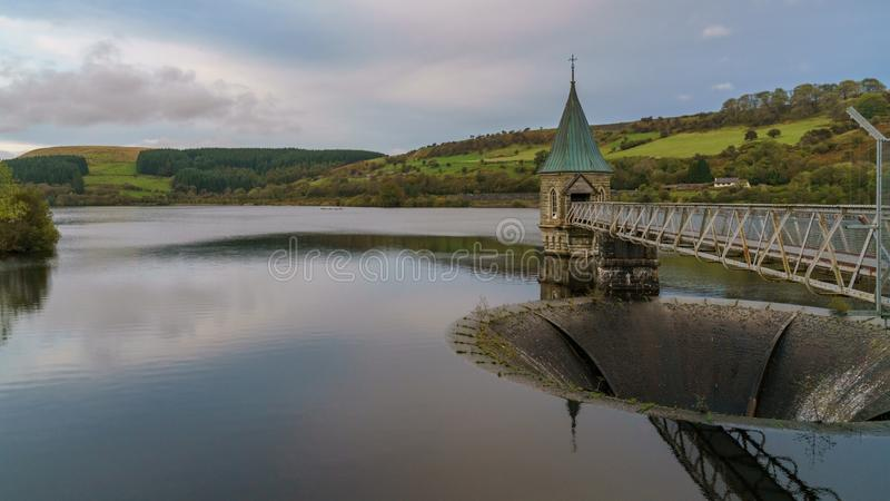 Pontsticill Reservoir, Merthyr Tydfil, Mid Glamorgan, Wales, UK. Evening view over the Pontsticill Reservoir and the Valve tower near Merthyr Tydfil, Mid royalty free stock photography