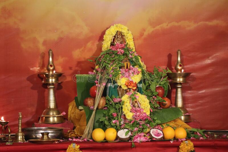 Pooja for Lord Vishnu and Lord Ganesha. Idols of Lord Vishnu and Lord Ganesha arranged for pooja with flowers, fruits, etc. Lord Vishnu is one of the gods in the royalty free stock photography