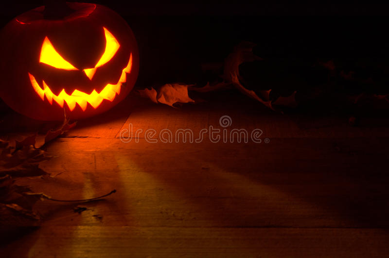 Pooky halloween background face of jack o lantern in the corner stock images