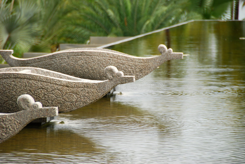 A pool arround by little sculpture(Hainan China) stock photography