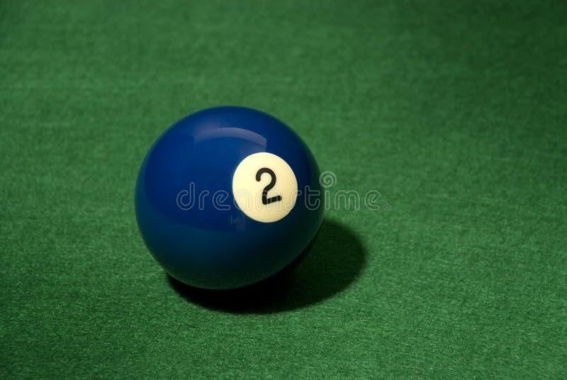 Pool ball 2. On green velvet stock images