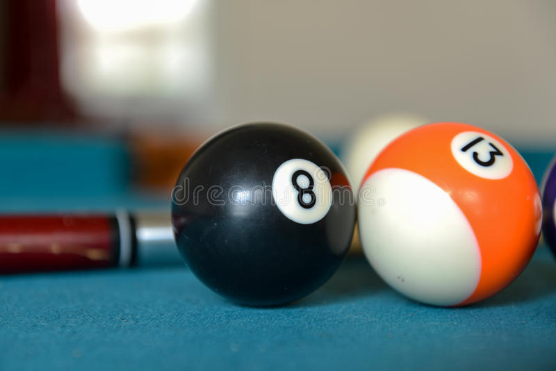 Pool balls cues and a ball rack stock photography