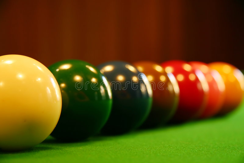 Pool balls on a green table royalty free stock photos