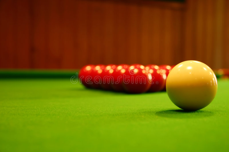 Pool balls on a green table stock photography