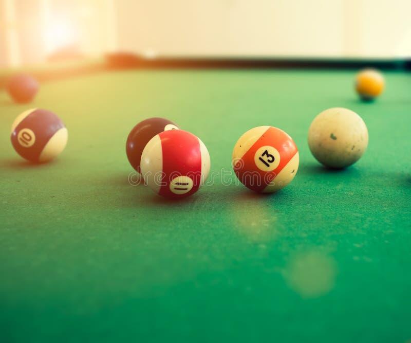 Pool balls on pool table stock photos