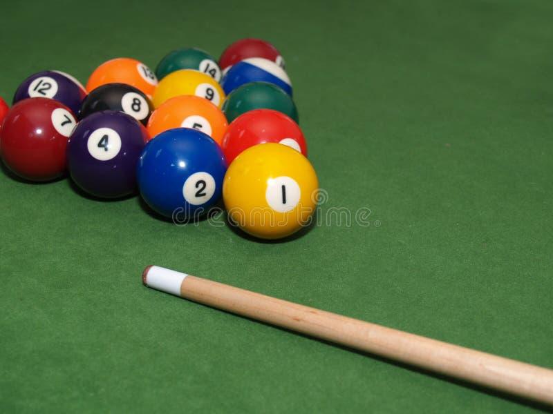 Pool balls on table stock photography