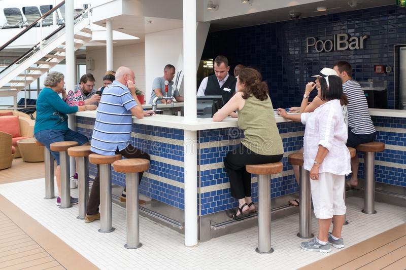 Pool Bar. Barcelona, Spain - September 7th 2015: People at the  pool bar onboard the Celebrity Equinox cruise ship. Bars are popular places onboard stock photo
